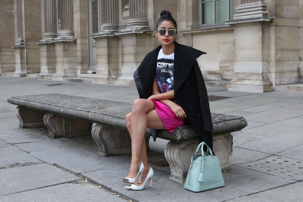 This styler played off a few trends at once, embracing cap-toe heels and a t-shirt right along with her bright mini.