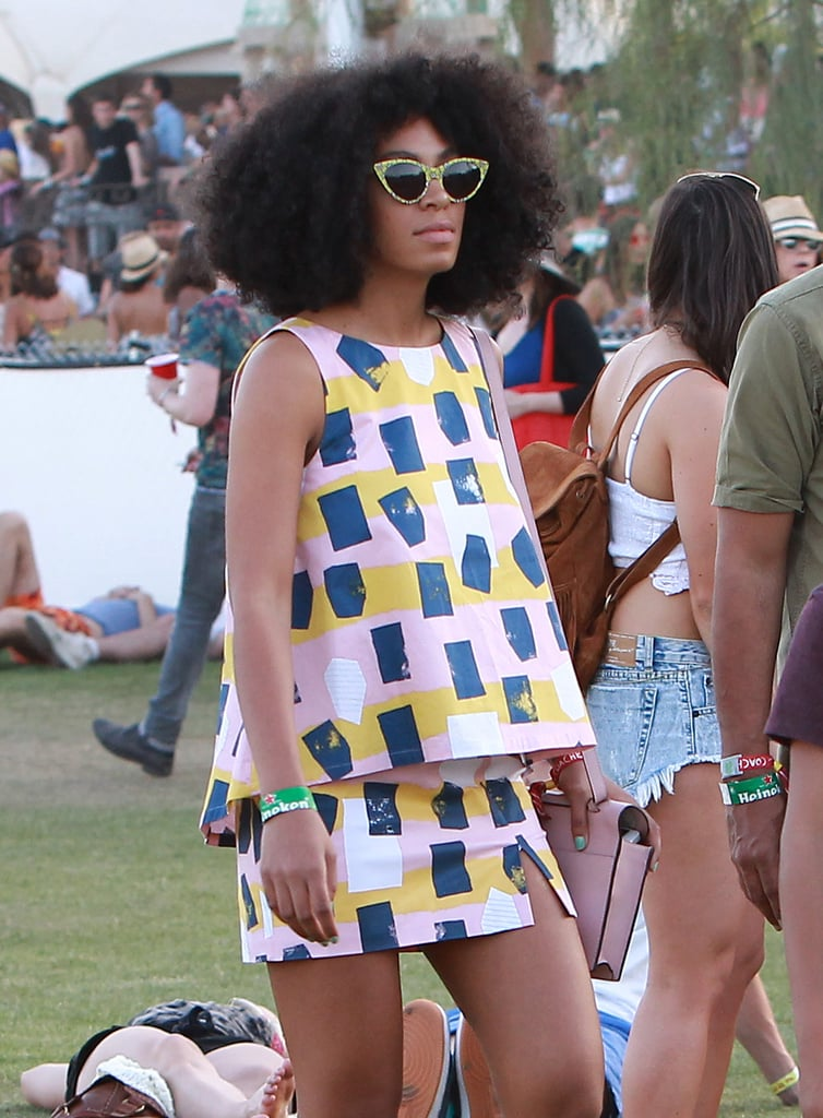 Solange Knowles sported a colorful outfit while listening to some music in 2014.