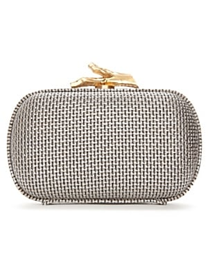 A metallic clutch like this goes with practically any party look without ever feeling too matchy-matchy.  Diane von Furstenberg Silver Canvas Box Clutch ($295)
