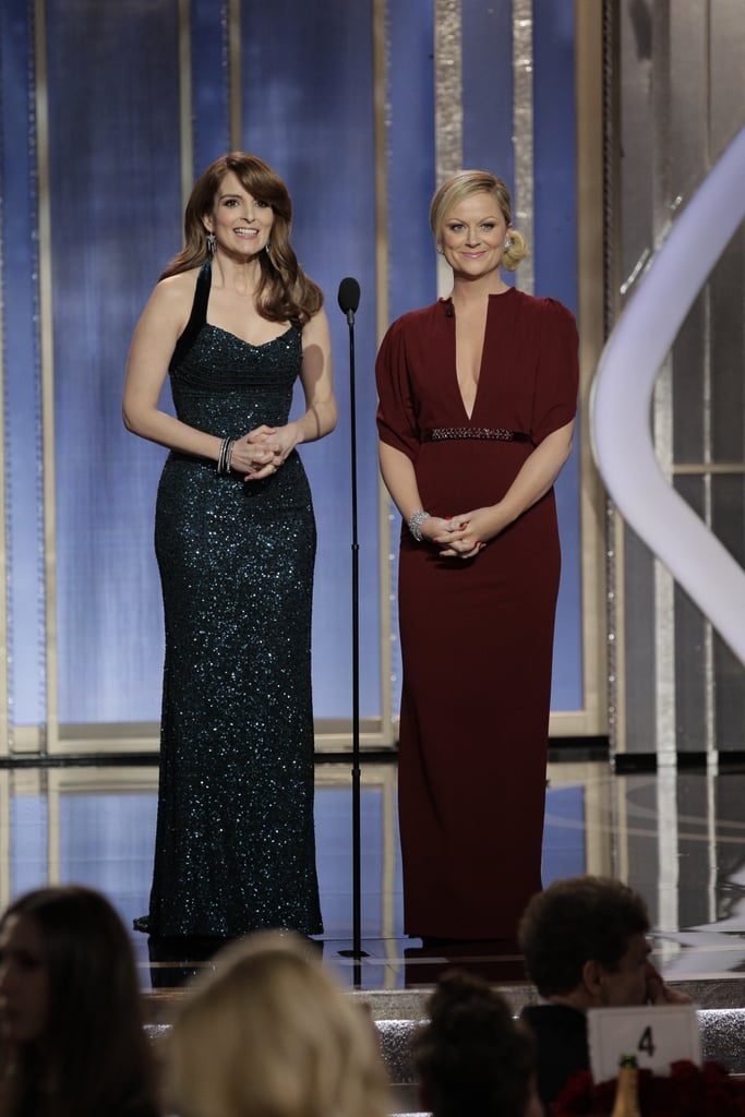 Co-host Amy Poehler donned a dark plum gown to host the Golden Globes.