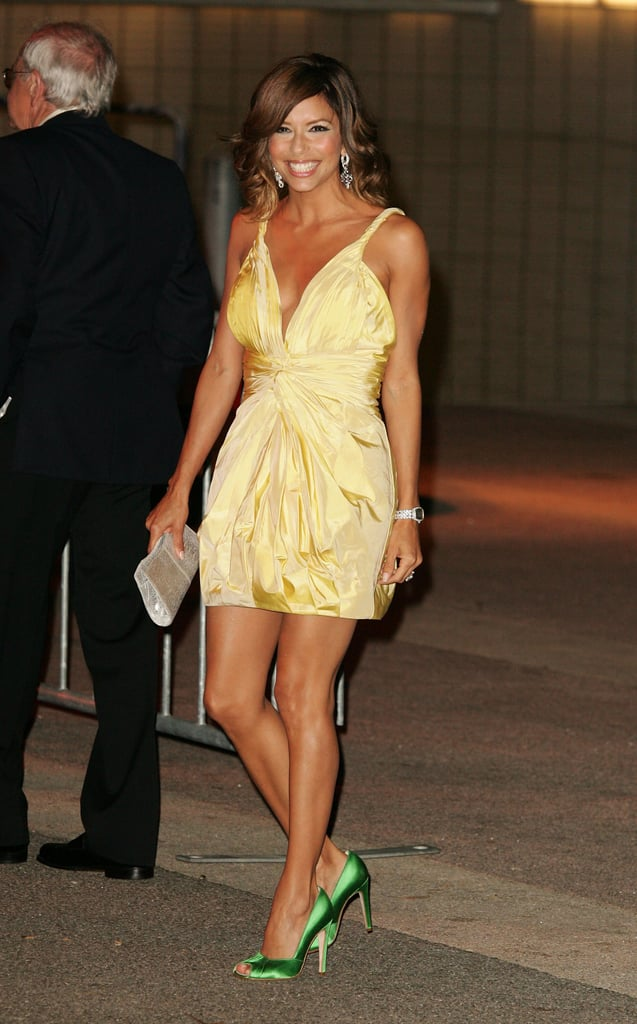 Shining bright like the sun in a satin limoncello mini and apple-green pumps, Eva welcomed the Beckhams to LA in style.