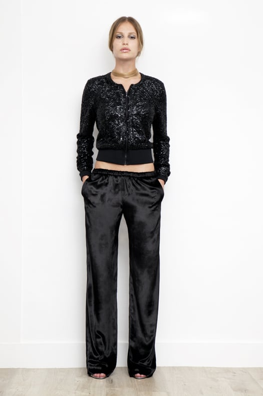Sequin Zip-Front Merino Cardigan in Black ($850), Velvet Track Pant in Black ($595), Whisper Sandal in Specchio ($650) Photo courtesy of Tamara Mellon