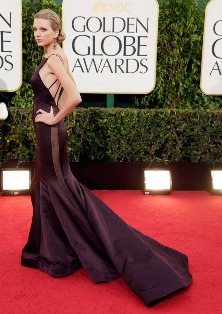 Taylor Swift wowed in a backless Donna Karan gown on the red carpet.