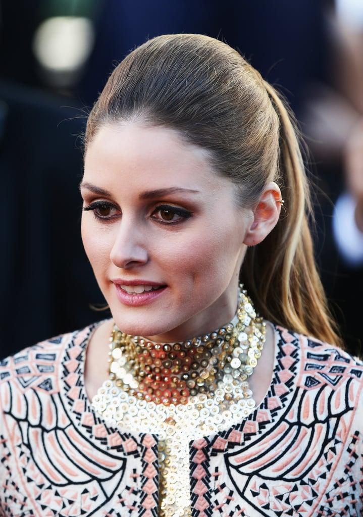 Olivia Palermo wore a sleek ponytail, thick dark eyeliner with a splash of gold eyeshadow.