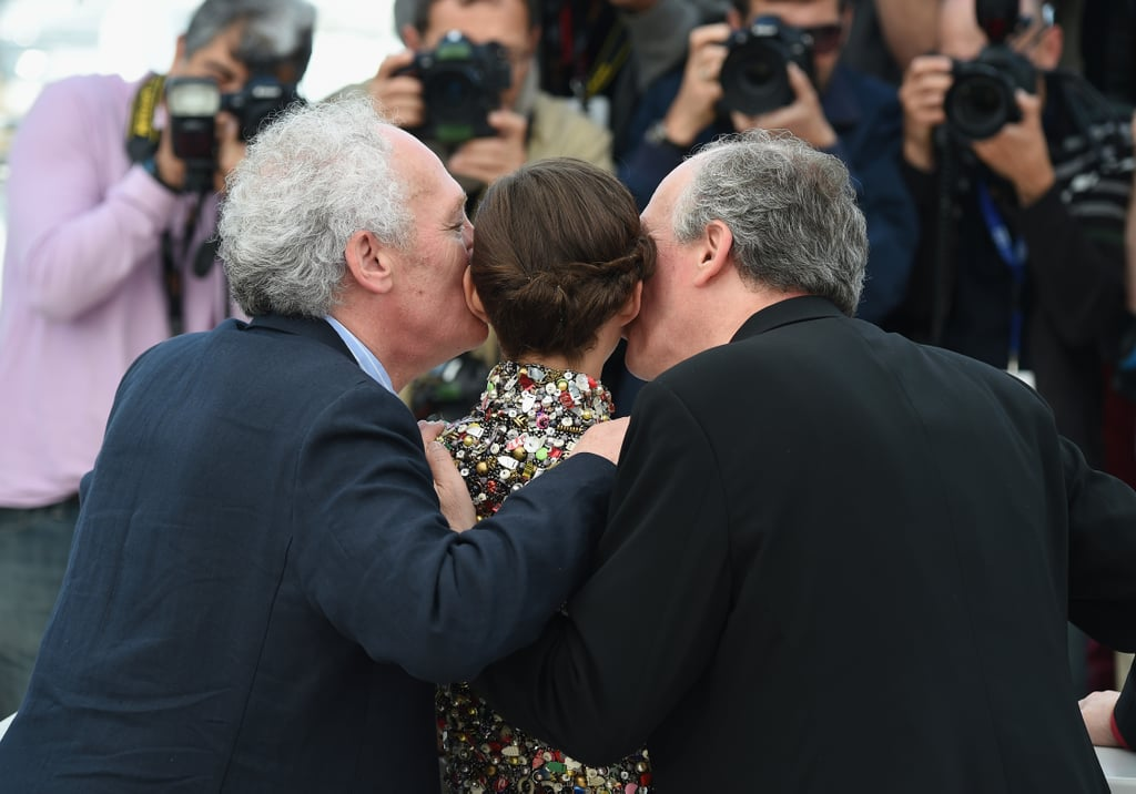Marion Cotillard got a double kiss from filmmakers Luc and Jean-Pierre Dardenne during the photocall for Two Days, One Night.