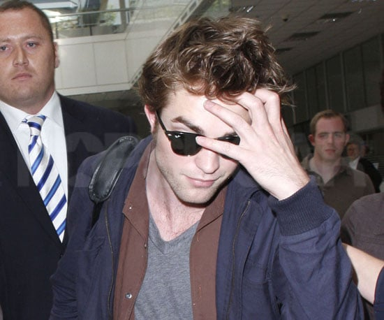 Photo Slide of Robert Pattinson Heading to Cannes from the Nice Airport