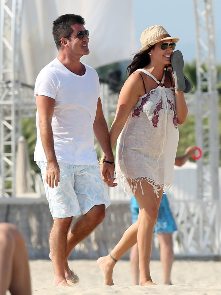 Simon Cowell and Lauren Silverman smiled on the beach together.