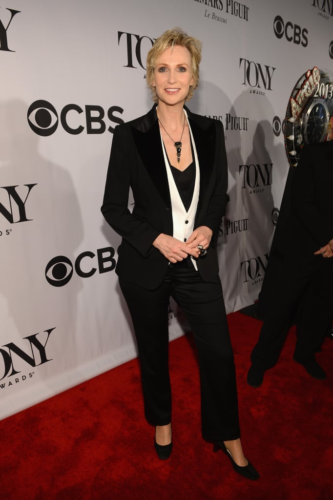 Jane Lynch ditched the gown in favor of easy-chic menswear, complete with a white vest and jeweled necklace.