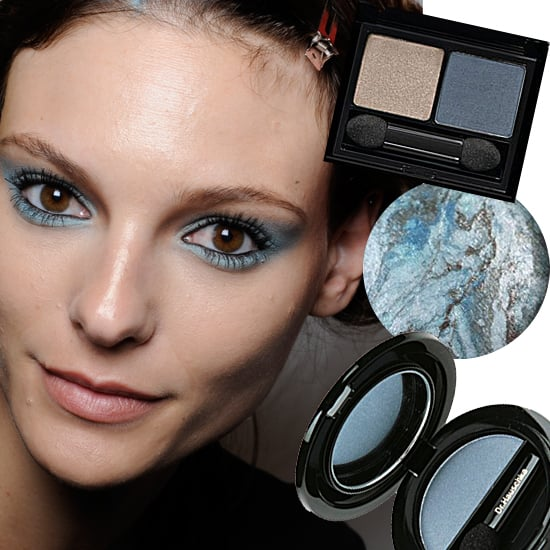 Blue Steel  Models sported this hybrid grey-blue hue at the L'Wren Scott Spring 2011 show. To make eyes really pop, pair this color with lots of black mascara . . . but be sure to keep the rest of your look neutral — lips look best when nearly nude, and skip the blush.  From top to bottom: Elizabeth Arden Intrigue Eyeshadow Duo in Blue Smoke, $25; Laura Geller Variagated Baked Eyeshadow in Blue Icing, $24; Dr.Hauschka Skin Care Eyeshadow Solo Eye Color in Smokey Blue, $20