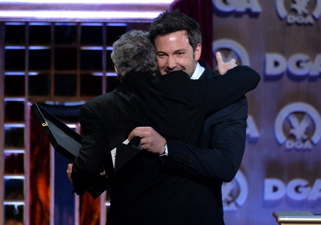 Ben Affleck gave Alfonso Cuarón a hug when the director joined him on stage.