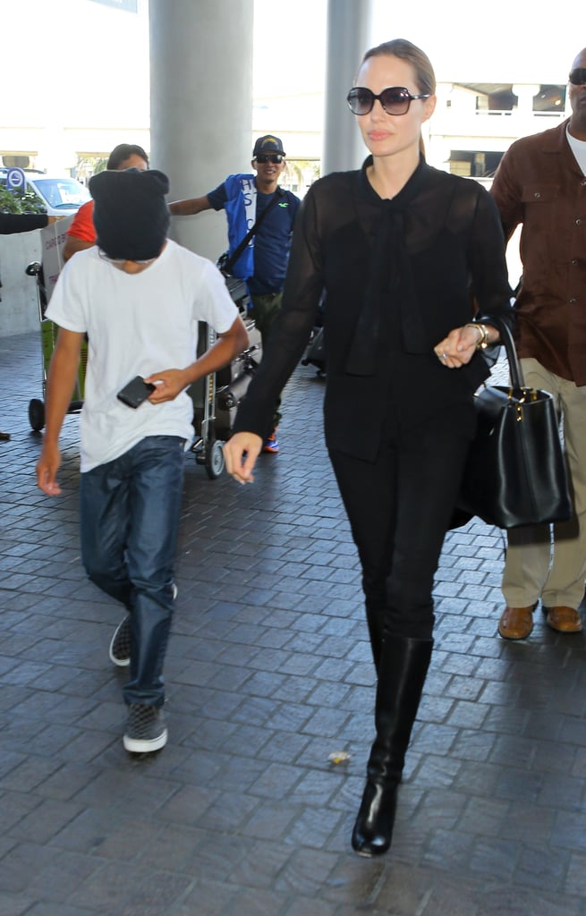 Angelina Jolie Takes Flight, This Time Without Maddox