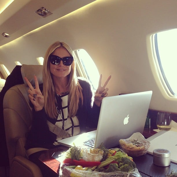 Heidi Klum flashed double peace signs during a flight to NYC. Source: Instagram user heidiklum