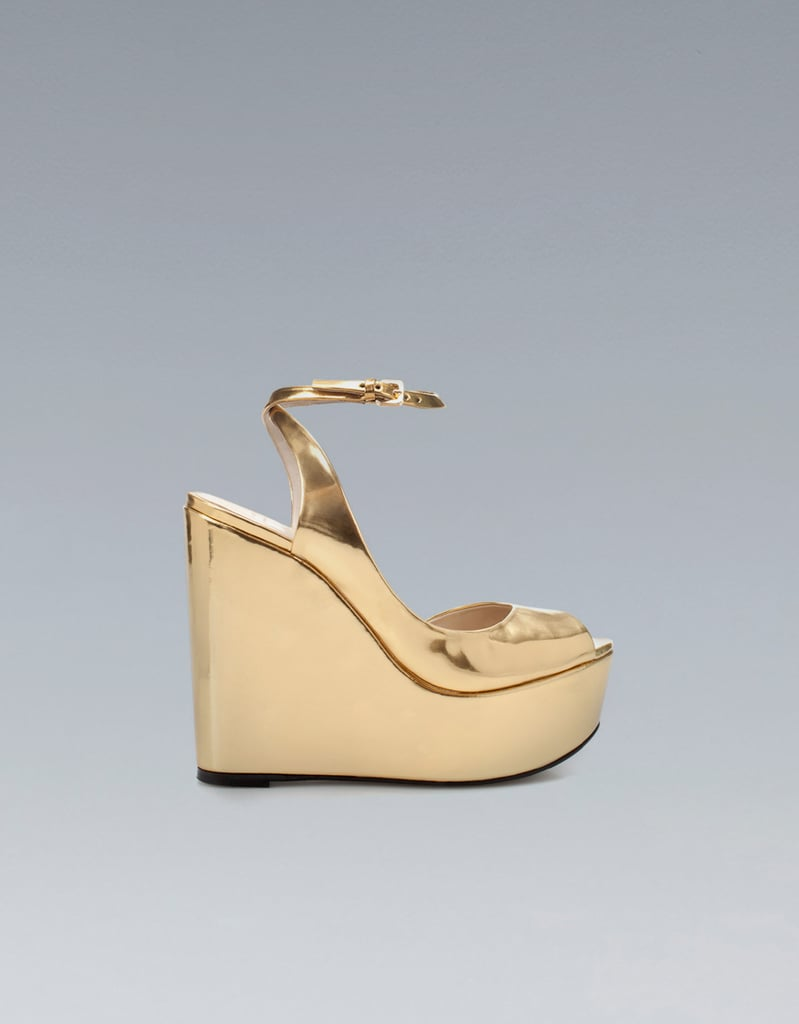 How amazing (and comfortable!) would these Zara Shiny Wedges ($100) with a sleek black jumpsuit?