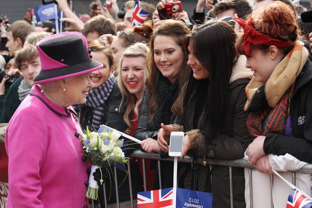 The queen chatted with the crowd.