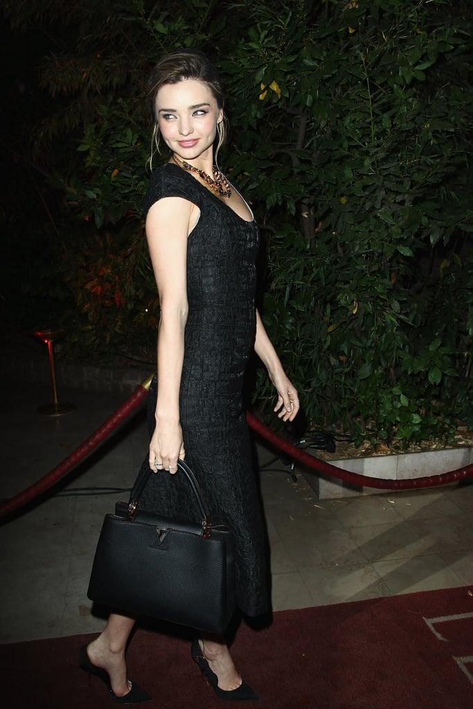 Miranda Kerr made an entrance at the Mademoiselle C bash in a black ensemble.