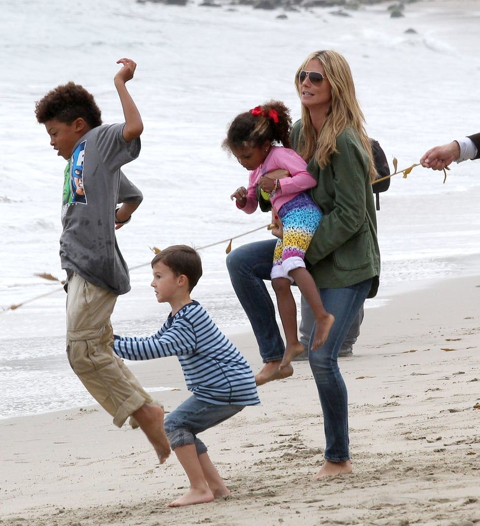 Heidi Klum had her hands full on the beach in LA on Saturday with her kids Henry and Lou and their friends.