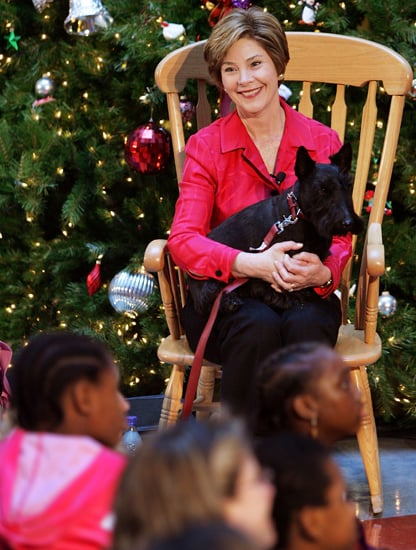 Former first lady Laura Bush brings Barney for a festive visit to the Children's National Medical Center. Source: Getty Images