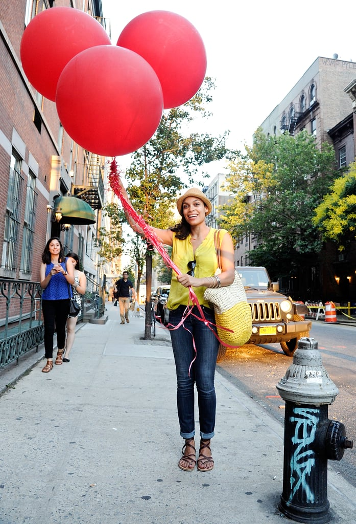 Rosario Dawson held some giant balloons in NYC on Thursday.