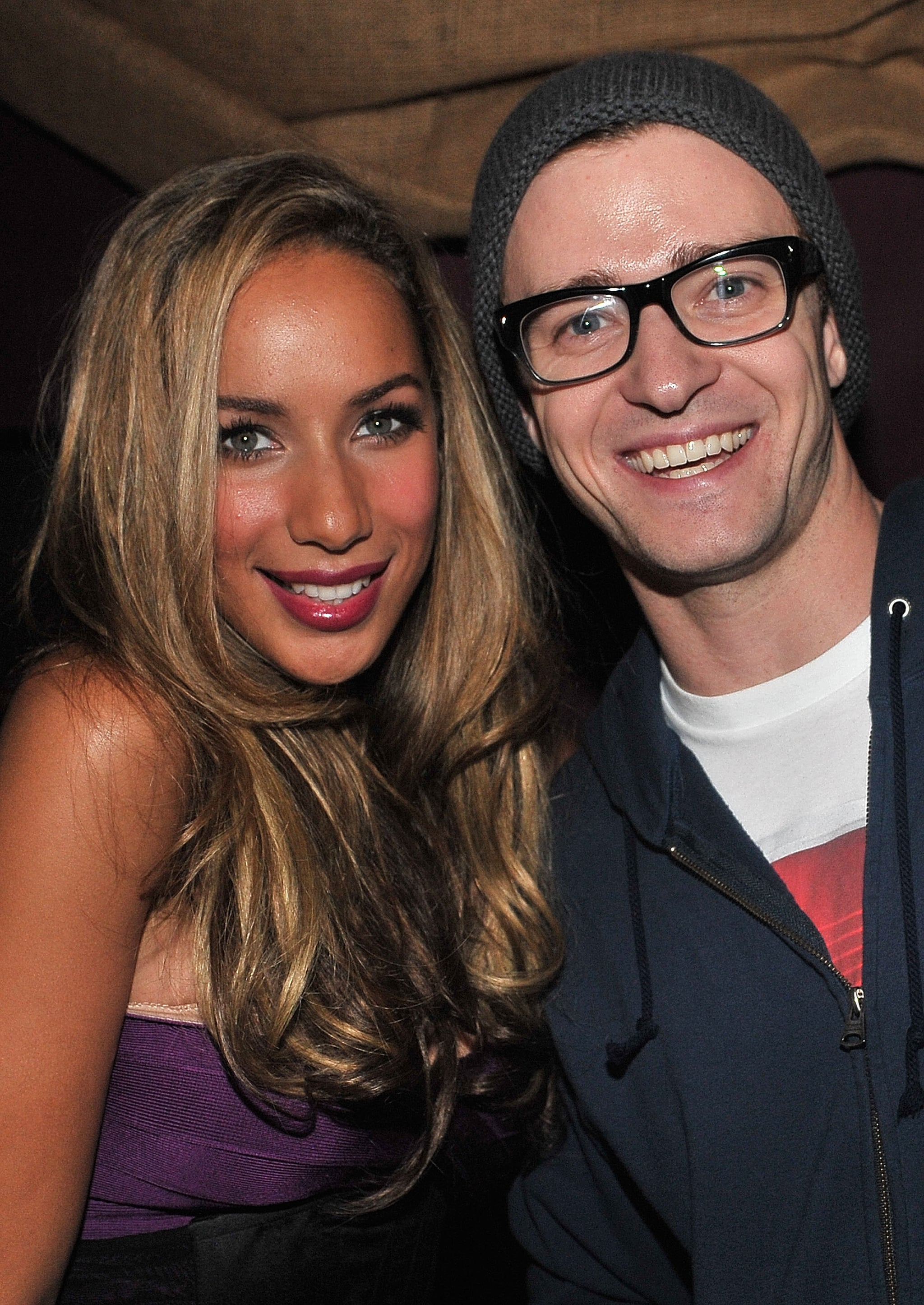 Looking hot in glasses and a beanie, Justin posed with Leona Lewis at her album release party in 2009.