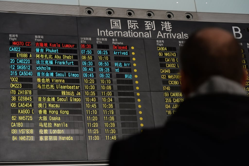 On Saturday, a man looked up at the arrival board at Beijing Capital International Airport, where the flight was expected to land.