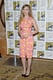 Scarlett Johansson wore a pink-and-yellow floral-print Versace dress at a press event for Marvel Studios.