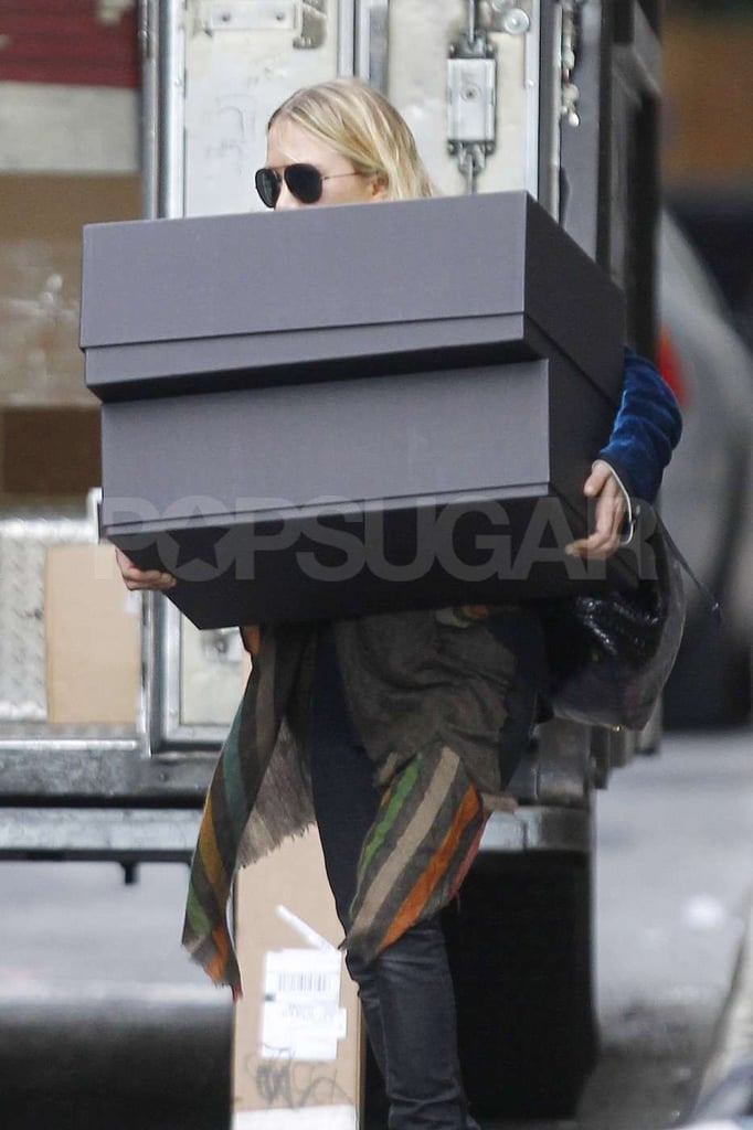 Mary-Kate Olsen carried two boxes that were almost the same size as her in NYC.