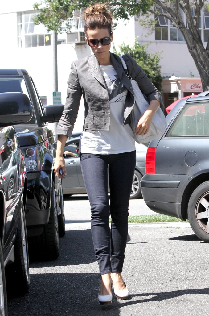 White pumps and a coordinating Yves Saint Laurent hobo sweetened her gray leather topper in May 2010.