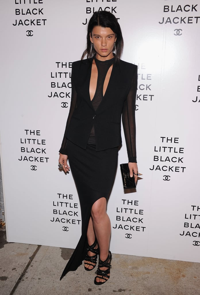 Crystal Renn chose a fashion-forward cutout tank and asymmetrical skirt, which she offset with a slick blazer. She played up the drama with a a pair of silver earrings, strappy gladiator-style heels, and a statement cocktail ring.