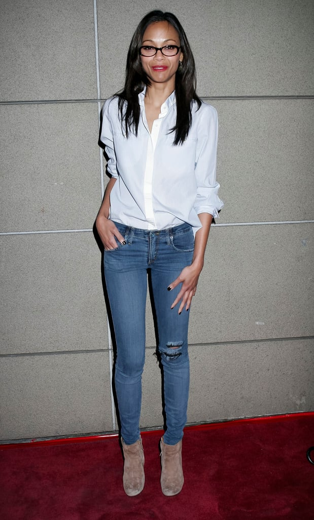 Just as easily as she can glam it up, she can keep it sleek and casual, too. Her white blouse, nude booties, and skinny jeans proved classic and cool.