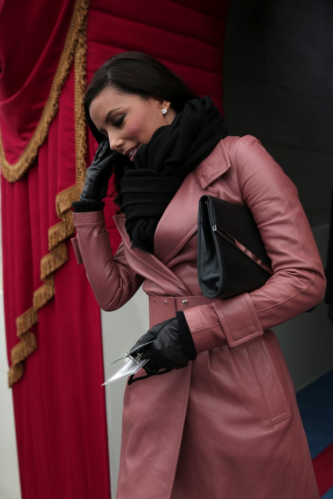 Eva's sleek black clutch, as well as her luxe black scarf and gloves, provided the perfect contrast to her pink leather Bally trench.