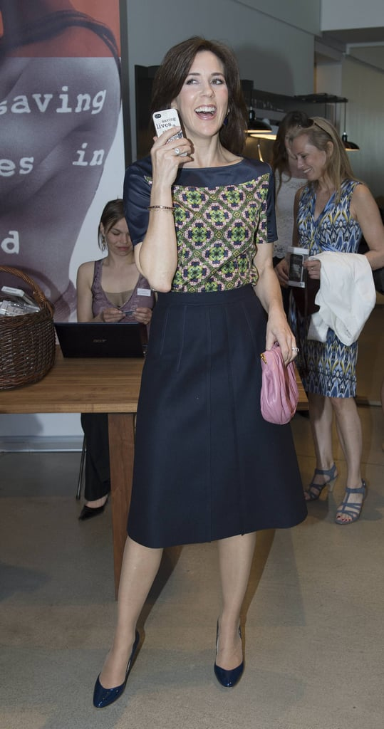 Mary's geo-print tunic top injects life into her tailored navy skirt.