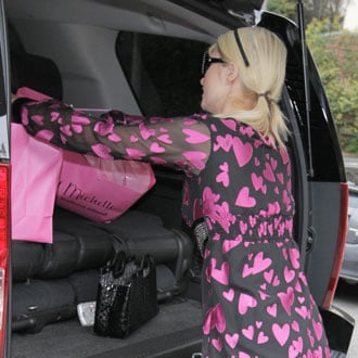 Guess Who's Loading Up Her Car?