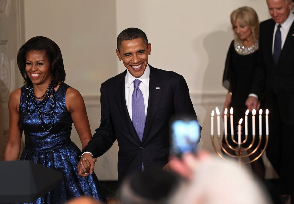 For the 2011 Hanukkah reception, the first lady wore a metallic blue Rodarte cocktail dress, complete with oversized blue beaded necklaces.