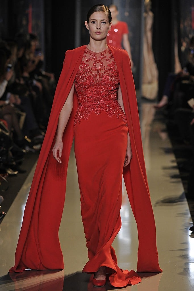 The red hue is downright stunning, but the elegant floor-legnth cape deserves a strong woman to be rocking this kind of look. We hope to see Jessica Chastain in this siren number, add-on and all.