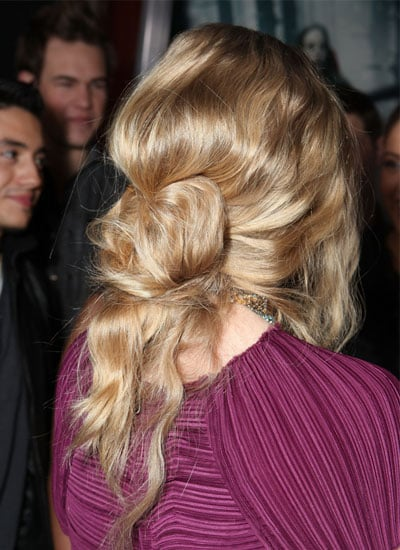 To create the twisted effect, wrap the top ponytail into a very loose bun. Pin any errant hairs into place, overlapping and twisting them to make the look more interesting. Spritz with hair spray to finish.