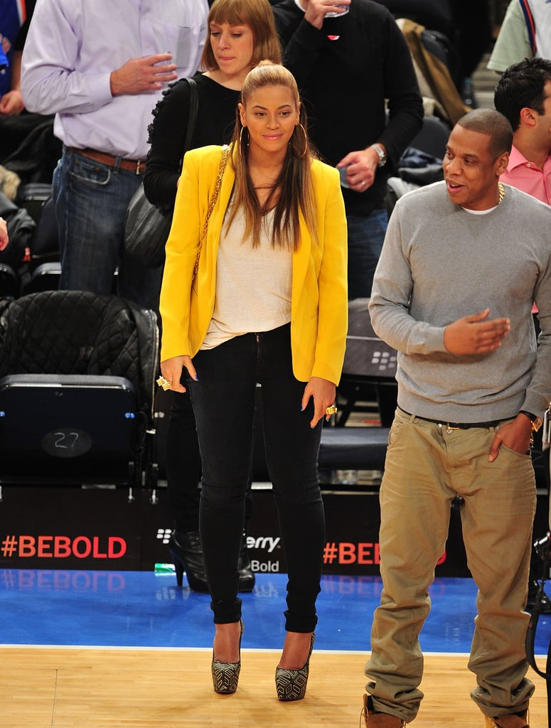 Beyoncé basically shows everyone how courtside glamour is done whenever she attends Brooklyn Nets games with her hubby (and part-owner of the team) Jay-Z. For a February 2012 game against the NY Knicks, Bey stepped out in black skinnies and a slouchy white tee, which she paired with a bright yellow Rag & Bone blazer and sky-high Christian Louboutin pumps.