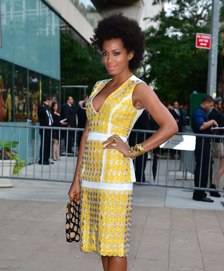 """Solange Knowles showed off her usual brand of """"I just threw this on"""" amazingness at the CFDA Awards. She paired her yellow Marni shirt dress with a smattering of gold rings in ranging widths."""