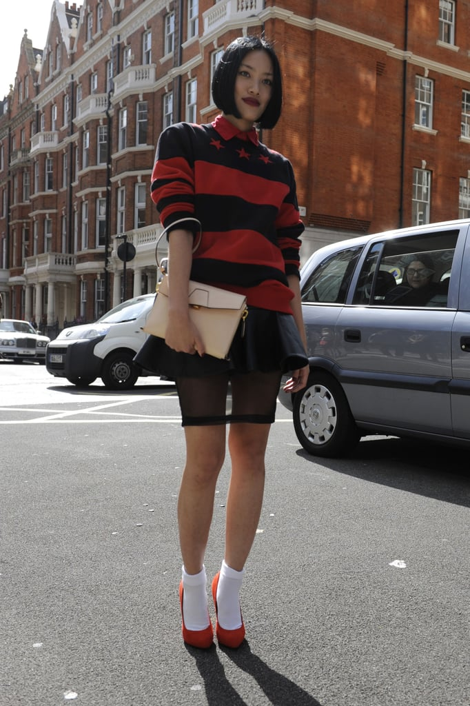 Rugby stripes got a girlie, whimsical counter in a sheer-trimmed skirt and pumps styled up with socks.