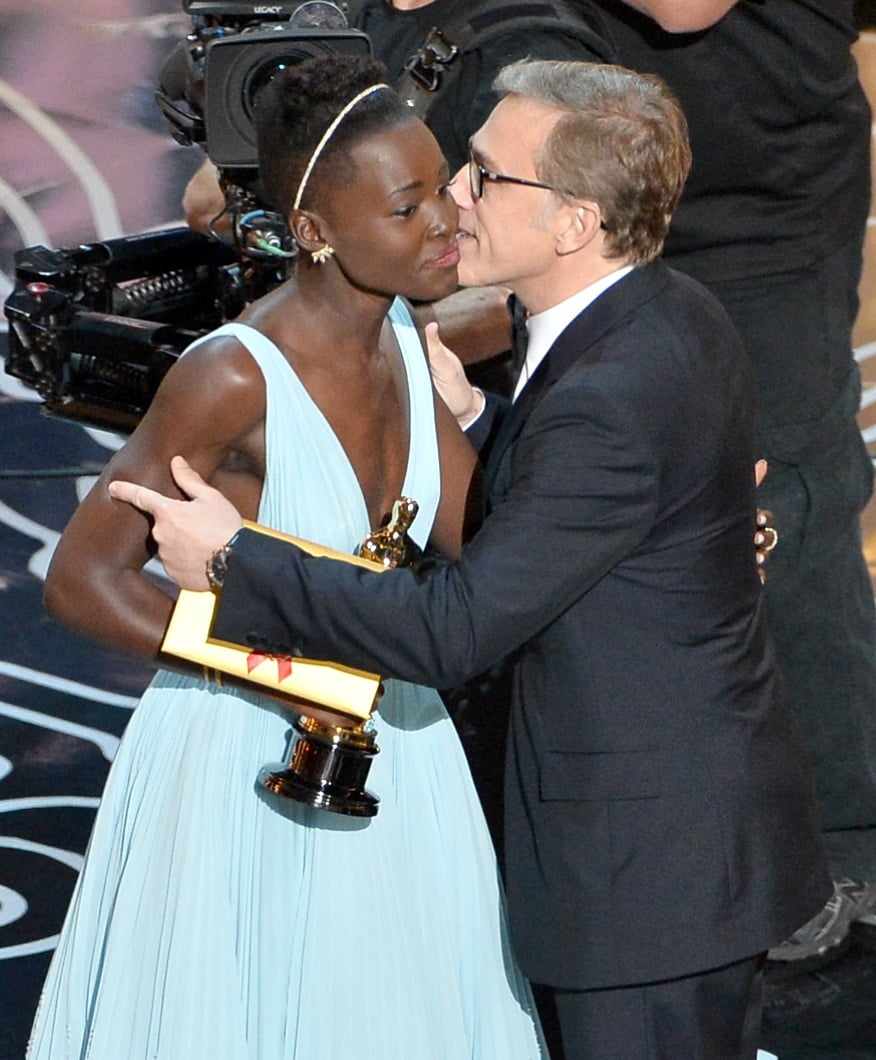 Christoph Waltz embraced Lupita Nyong'o after presenting her with the Oscar for best actress.