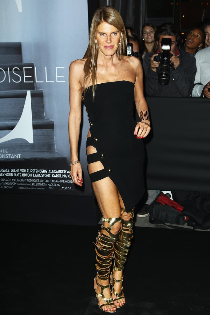 In Paris, Anna Dello Russo's boots were made for walking into the Mademoiselle C bash. A sexy tube dress and gold watch and cuff completed the look.