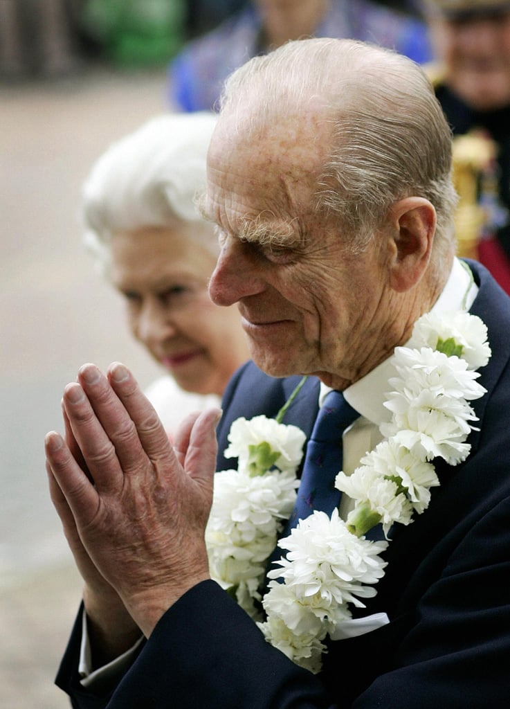 Prince Philip clasped his hands as the pair arrived for a visit to the Sikh Temple in Hounslow, West London.
