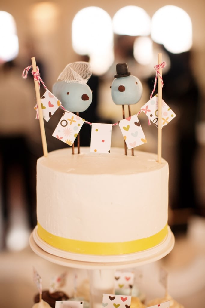 Even supersimple cakes can bring on the fun factor. Just look at this quirky husband-and-wife topper adorning a white-and-yellow cake.