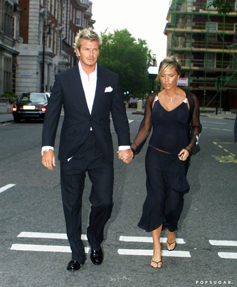 Victoria was pregnant with son Romeo in July 2002 as she and David attended the christening of Elizabeth Hurley's son in London.