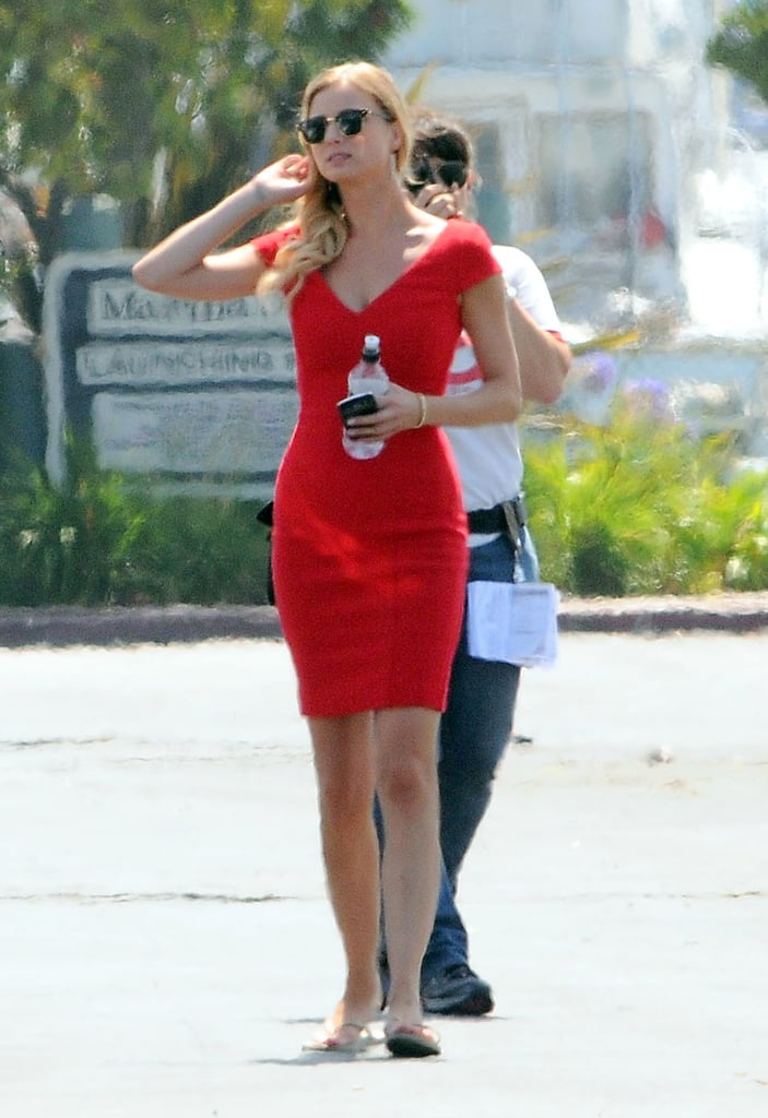 Emily VanCamp wore a red dress on the set of Revenge.