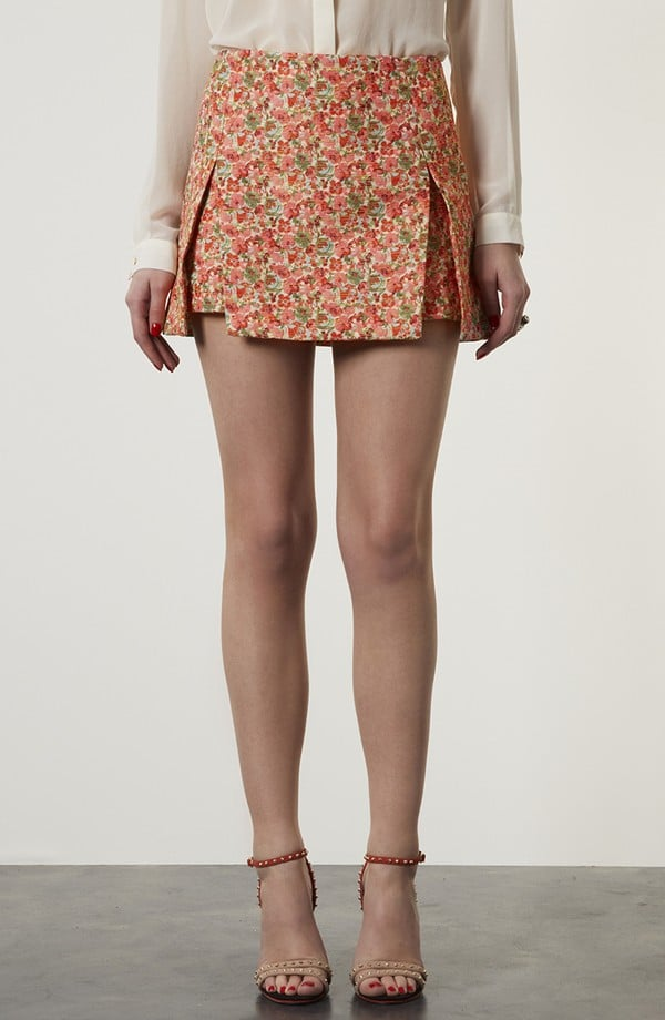 This sweet Topshop Floral Origami Skirt ($30, originally $80) is begging to be worn with a crisp white button-down and loafers now, but don't underestimate how chic it will look with black tights and boots later.