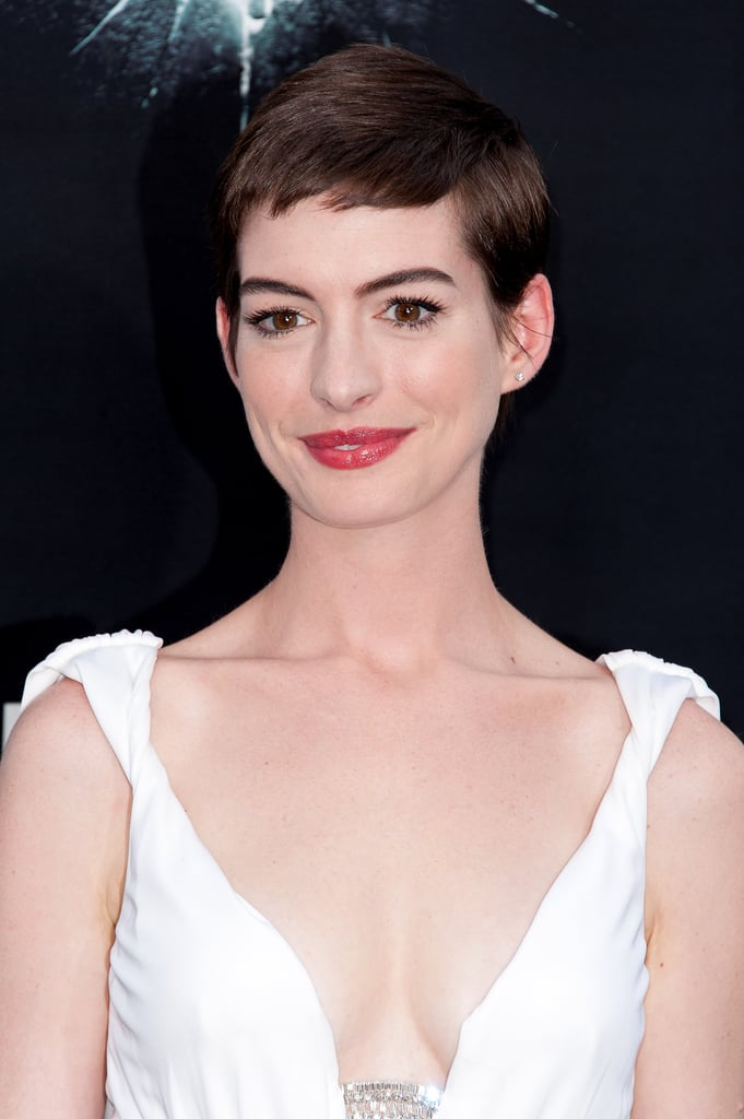 Anne made the big chop for her role in Les Misérables and debuted the look on the red carpet earlier this year. She kept her makeup simple, though, with full lashes and a pink lip look.