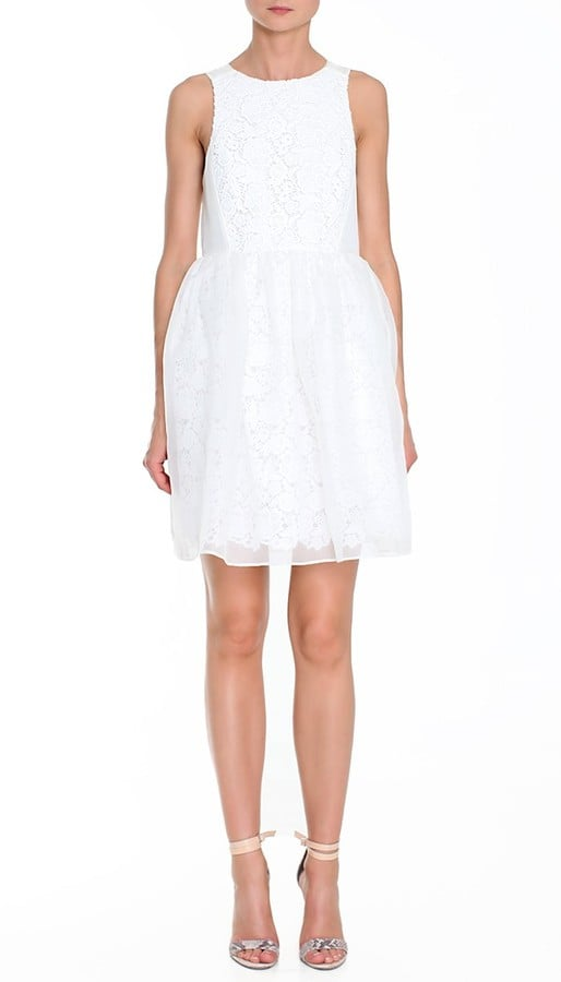 We love this frothy white cocktail dress — pair it with nude heels or metallic sandals.  Tibi Sacha Lace Dress ($680)