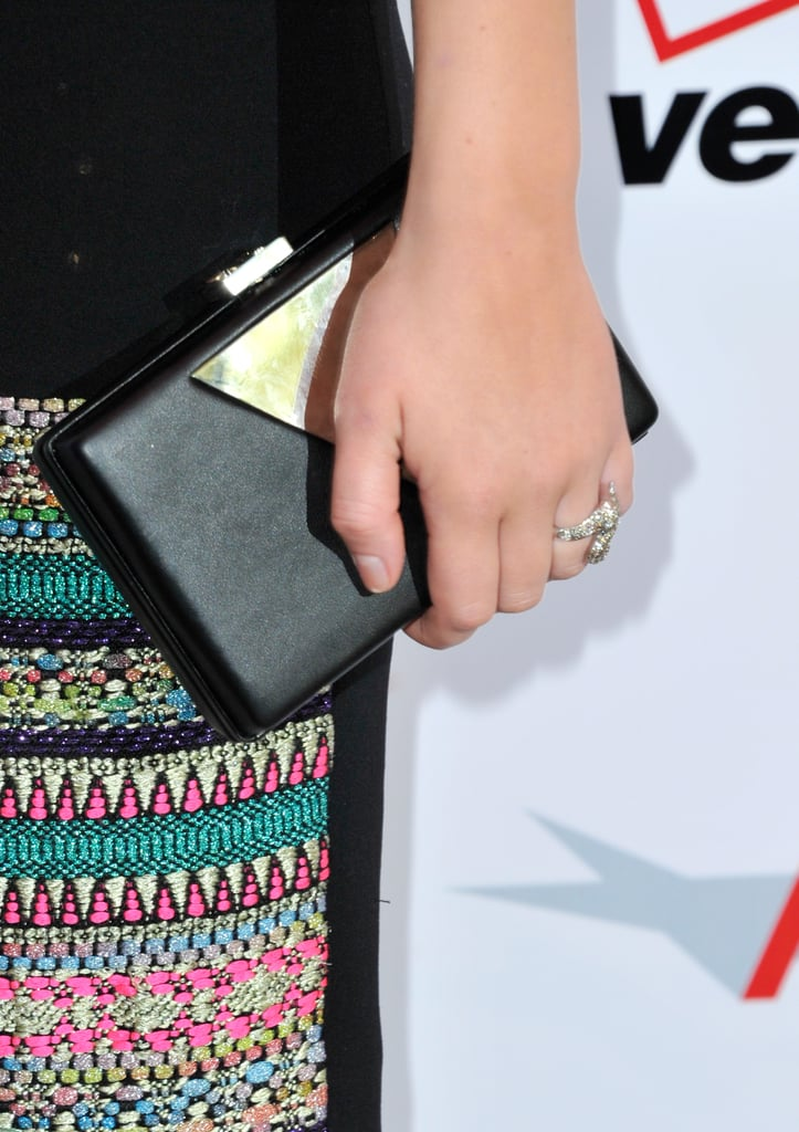 Jennifer Lawrence carried a slim back and gold clutch by Jill Milan.