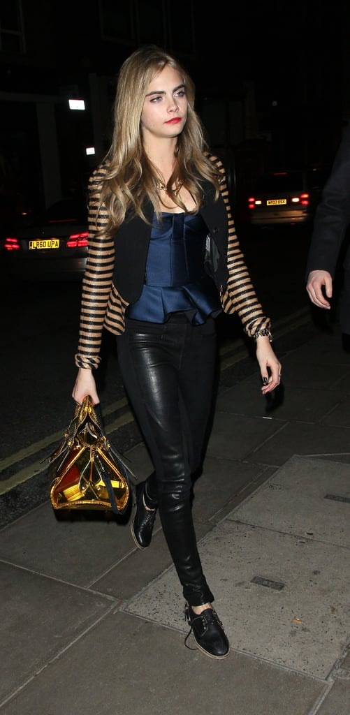 During a fancy night out in London, Cara Delevingne kept it luxe in a Burberry peplum top, black leather pants, and lace-up oxfords.