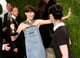 Anne Hathaway greeted Sarah Silverman on the red carpet.